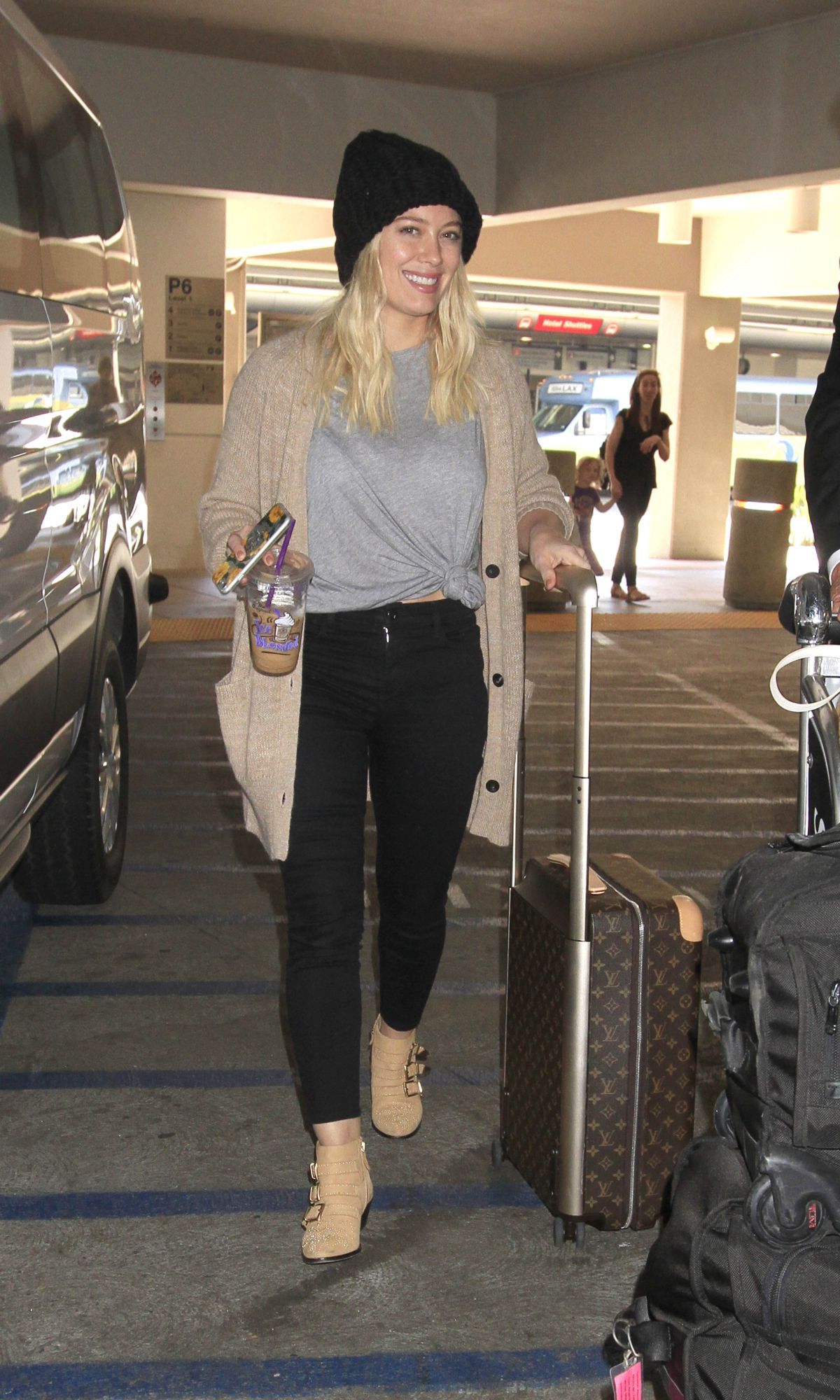 HILARY DUFF at Los Angeles International Airport 03/09/2017