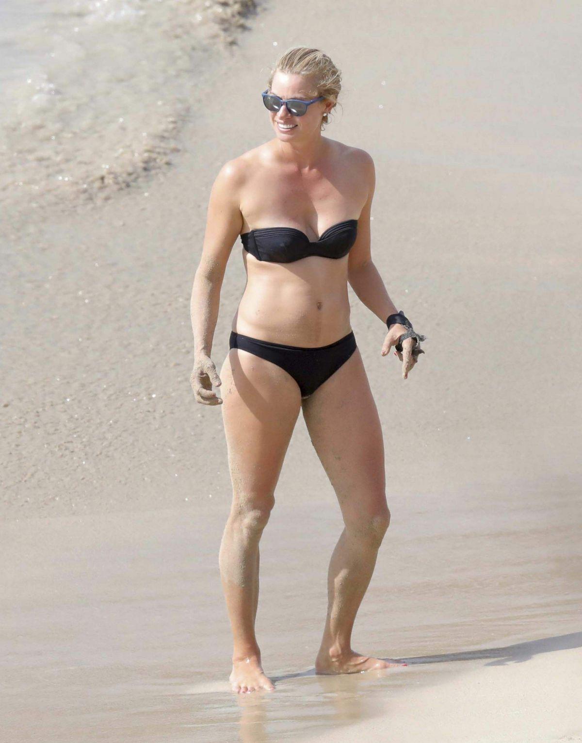KRISTY HINZE in Bikini at a Beach in St Barts 03/23/2017