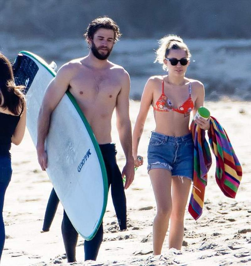 MILEY CYRUS and Liam Hemsworth at a Beach in Malibu 03/01 ...