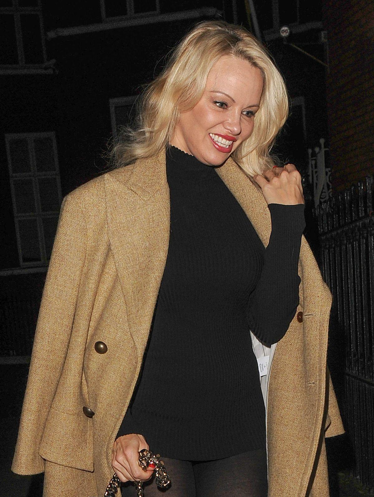 PAMELA ANDERSON Arrives at Julian Assange Home in London ... Pamela Anderson