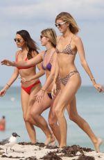 RACHEL HILBERT and DEVON WINDSOR in Bikinis on the Beach in Miami 03/14/2017
