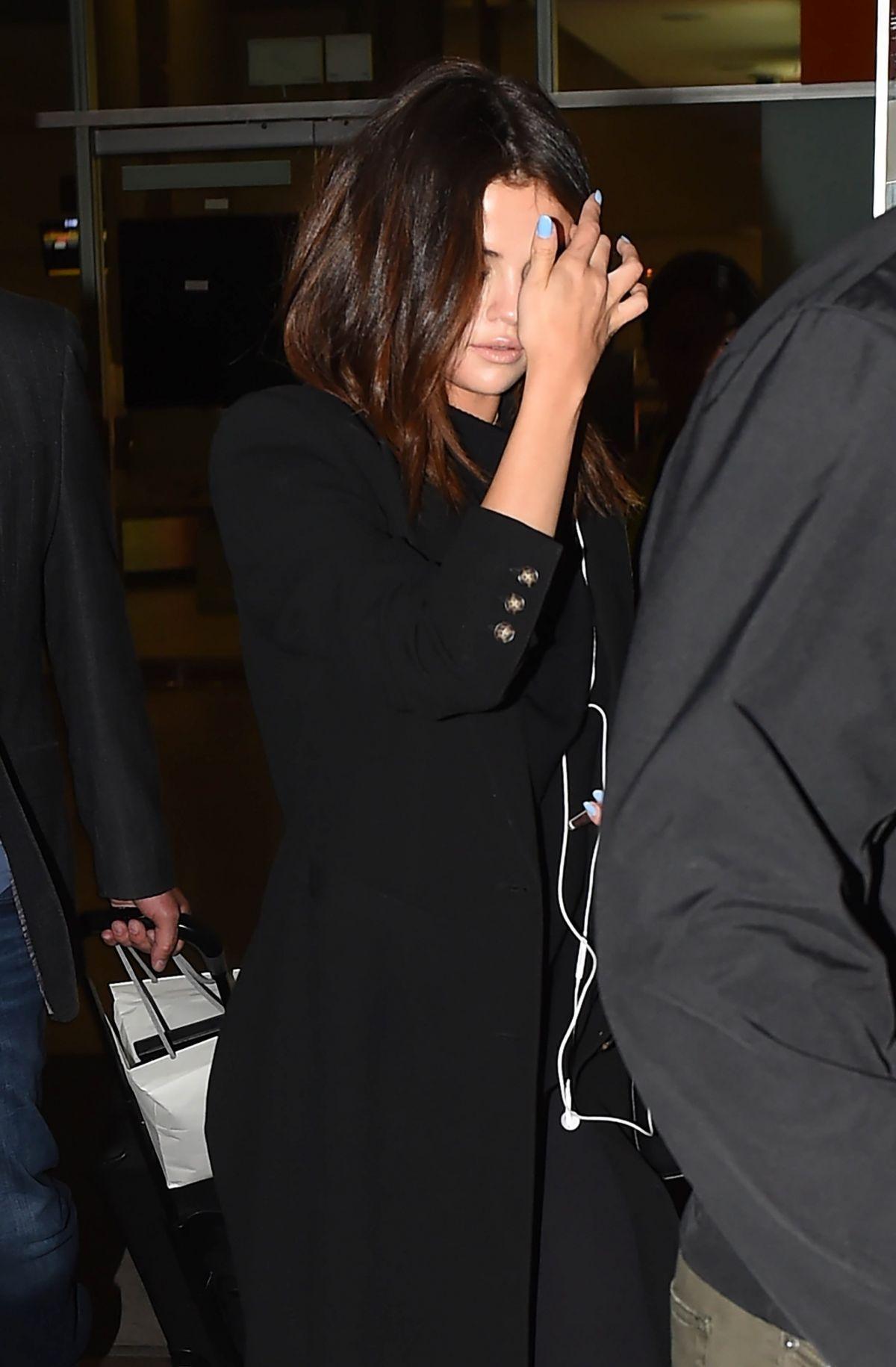 SELENA GOMEZ Arrives at Airport in Bogota 03/24/2017