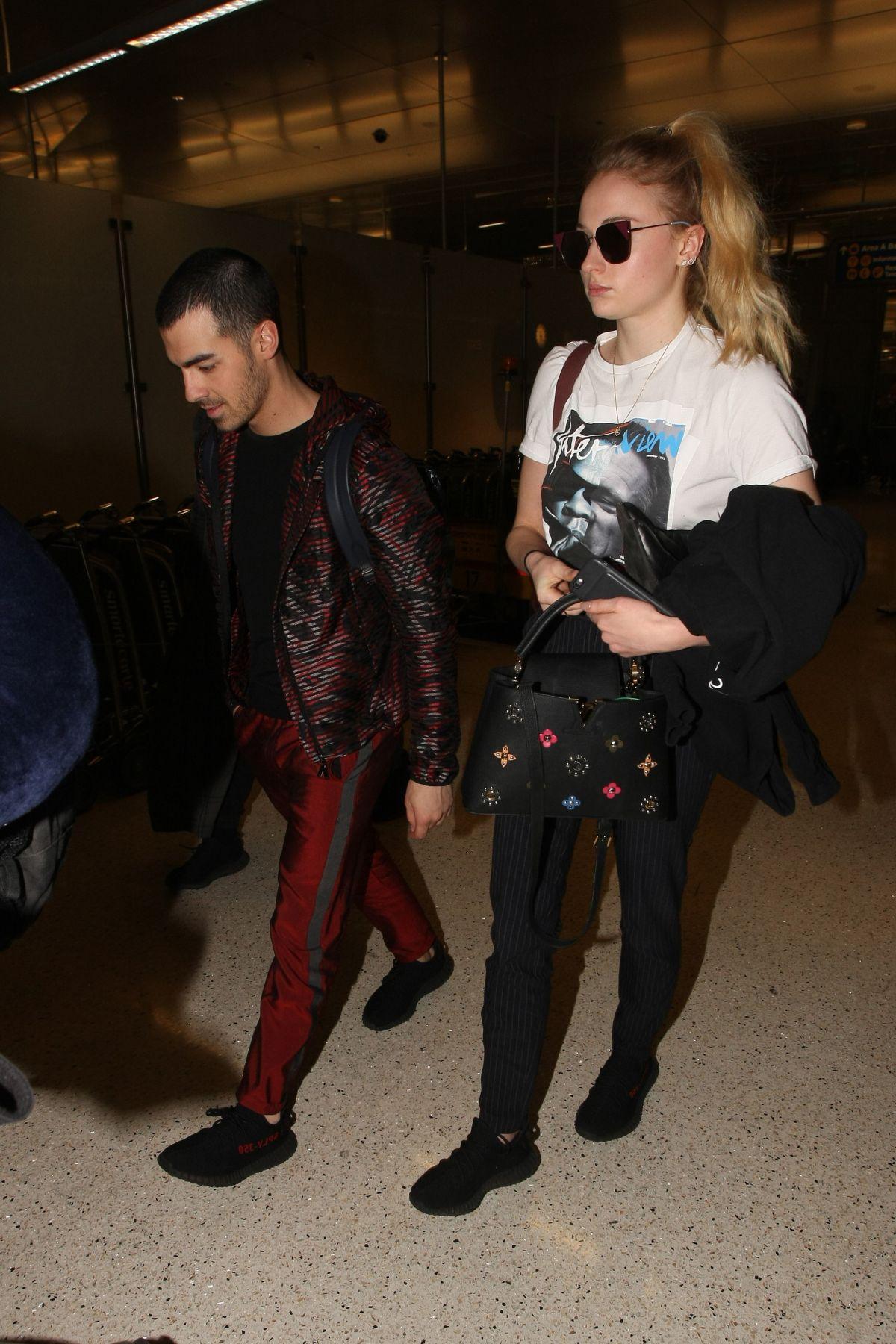 SOPHIE TURNER and Joe Jonas at LAX Airport in Los Angeles 03/05/2017