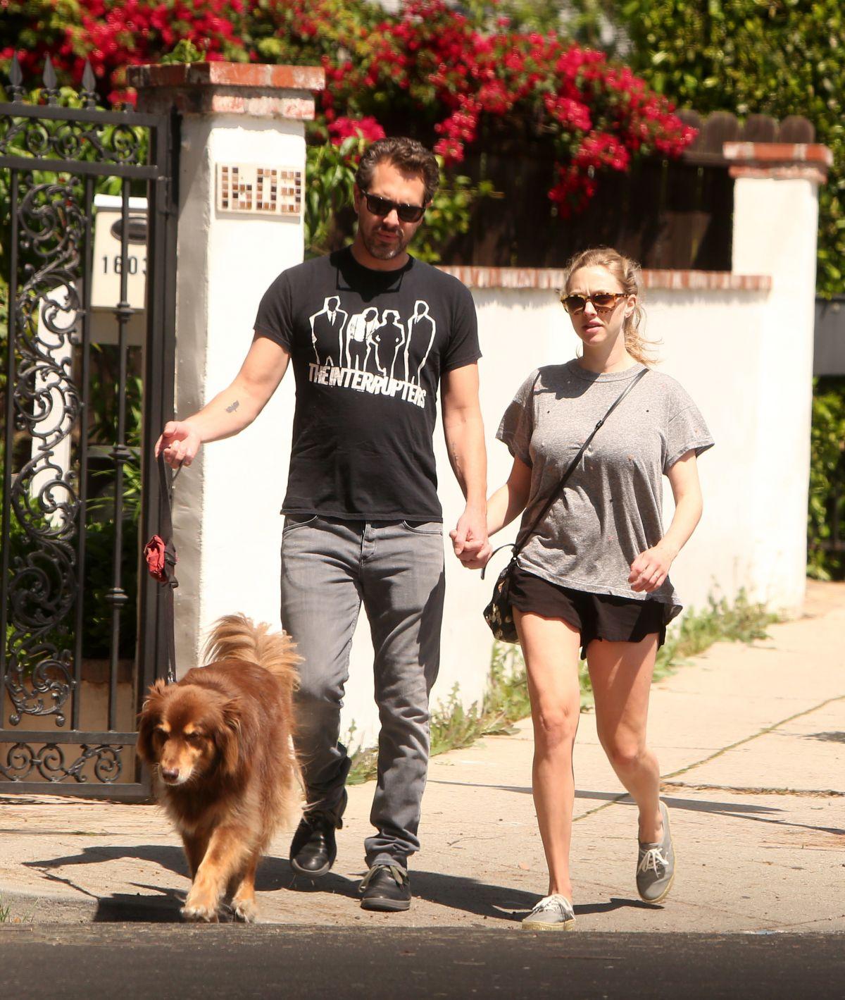 AMANDA SEYFRIED and Thomas Sadoski Walk Their Dog Out in Los Angeles 04/14/2017