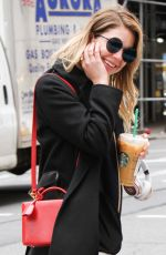 ASHLEY BENSON Leaves Starbucks in New York 04/19/2017
