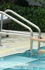 BELLA HADID in Bikini at a Pool in Miami 04/28/2017