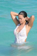 BROOKE BURKE in Swimsuit at a Beach in St. Barths 04/04/2017