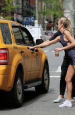 CANDICE SWANEPOEL Hails a Cab in New York 04/28/2017