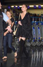 CHRISSY TEIGEN at JFK Airport in Los Angeles 04/12/2017