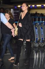 CHRISSY TEIGEN at JFK Airport in Los Angeles 04/12/2017
