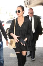 CHRISSY TEIGEN at LAX Airport in Los Angeles 04/12/2017
