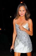 CHRISSY TEIGEN in a Silver Mini Dress Night Out in New York 04/23/2017