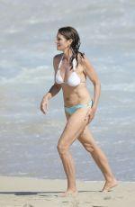 CINDY CRAWFORD in Bikini at a Beach in St Barth 04/07/2017