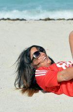 CLAUDIA ROMANI in Bikini Bottom on the Set of a Photoshoot 04/25/2017