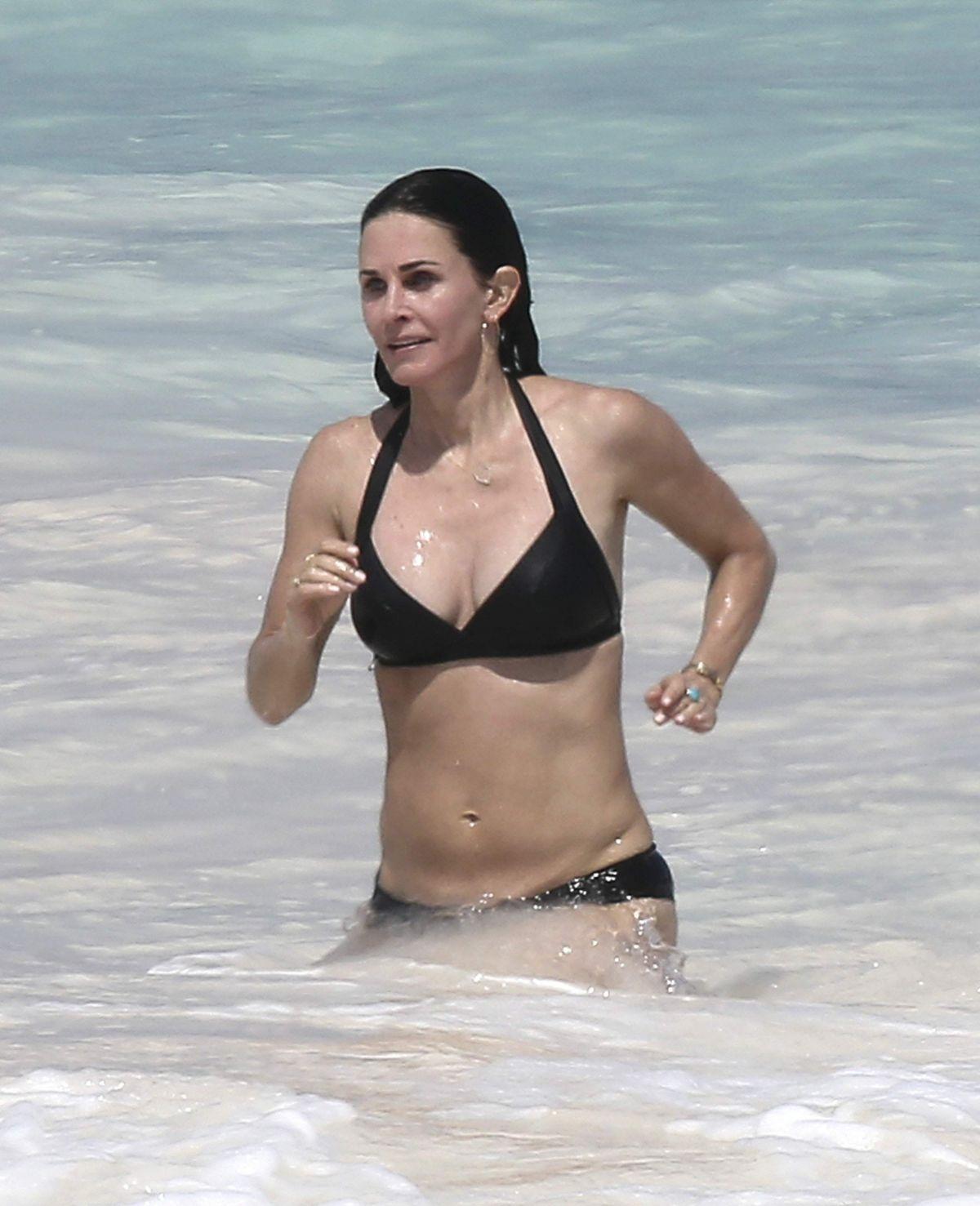 COURTENEY COX in Bikini on the Beach in Bahamas 04/02/2017 ...