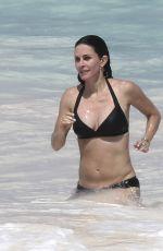 COURTENEY COX in Bikini on the Beach in Bahamas 04/02/2017