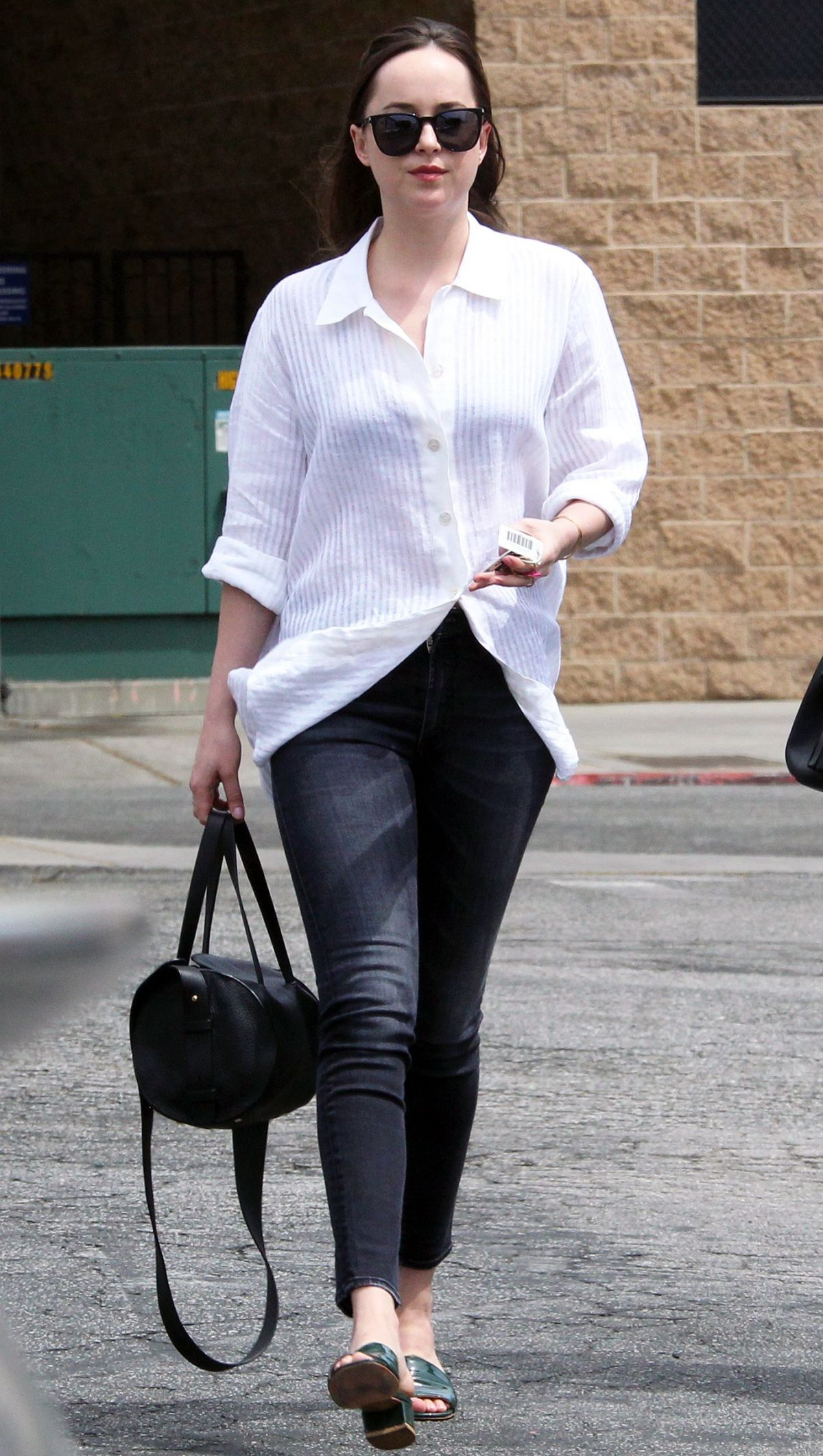 DAKOTA JOHNSON Out and About in West Hollywood 04/17/2017
