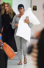 DEMI LOVATO at JFK Airport in New York 04/25/2017