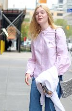ELLE FANNING Out and About in New York 04/22/2017
