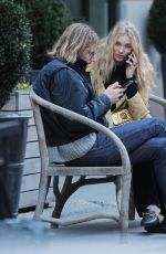 ELSA HOSK and Tom Daly on a bench in New York 04/09/2017