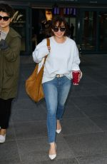 EMILIA CLARKE in Jeans at Heathrow Airport in London 04/20/2017