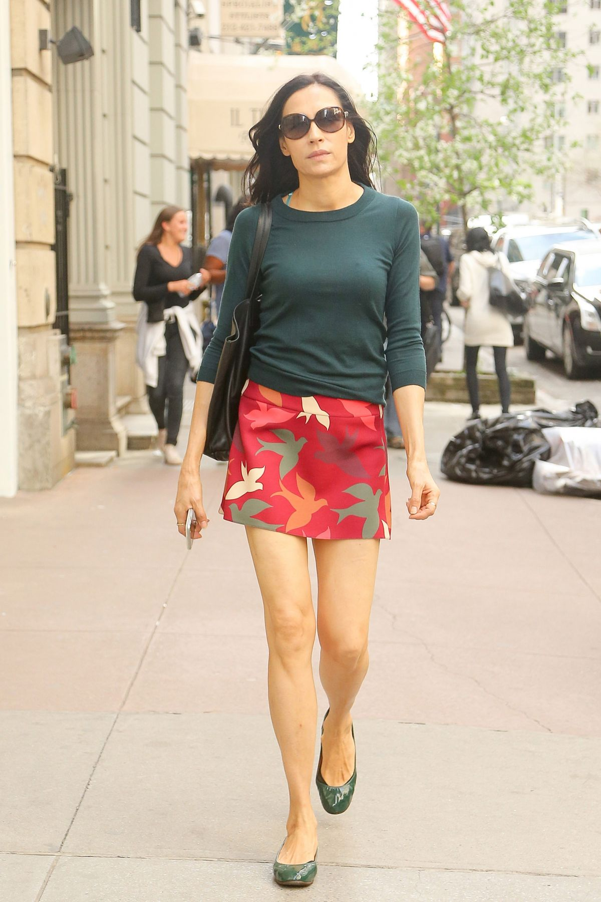 FAMKE JANSSEN in Short Skirt Out in New York 04/17/2017 ...