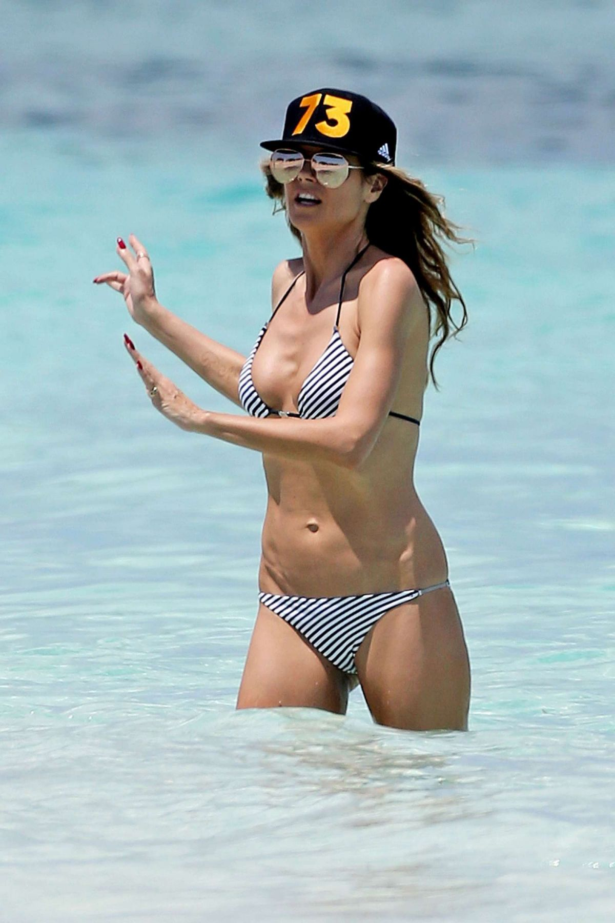 HEIDI KLUM in Bikini on the Beach in Turks & Caicos 04/02/2017