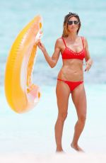 HEIDI KLUM in Bkini on the Beach at Caicos Islands 04/06/2017