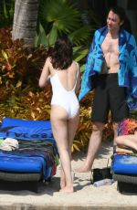 DAKOTA JOHNSON in Swimsuit at a Beach in Miami 04/02/2017