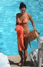 LUCY MECKLENBURGH in Bikini at a Pool at Beverly Hilton Hotel in Beverly Hills 04/20/2017