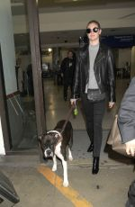 KATE UPTON with Her Dog at LAX Airport in Los Angeles 04/10/2017