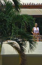 KIM KARDASHIAN in Bikini Bottom at a Pool in Mexico 04/25/2017\