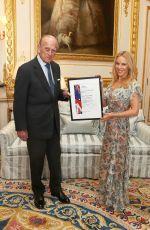 KYLIE MINOGUE at Windsor Castle Receiving Britain-Australia Society Award 04/04/2017