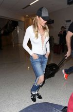 LEANN RIMES in Ripped Jean at LAX Airport in Los Angele 03/31/2017