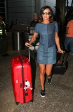 LUCY MECKLENBURGH in Denim Dress at LAX Airport in Los Angeles 04/10/2017