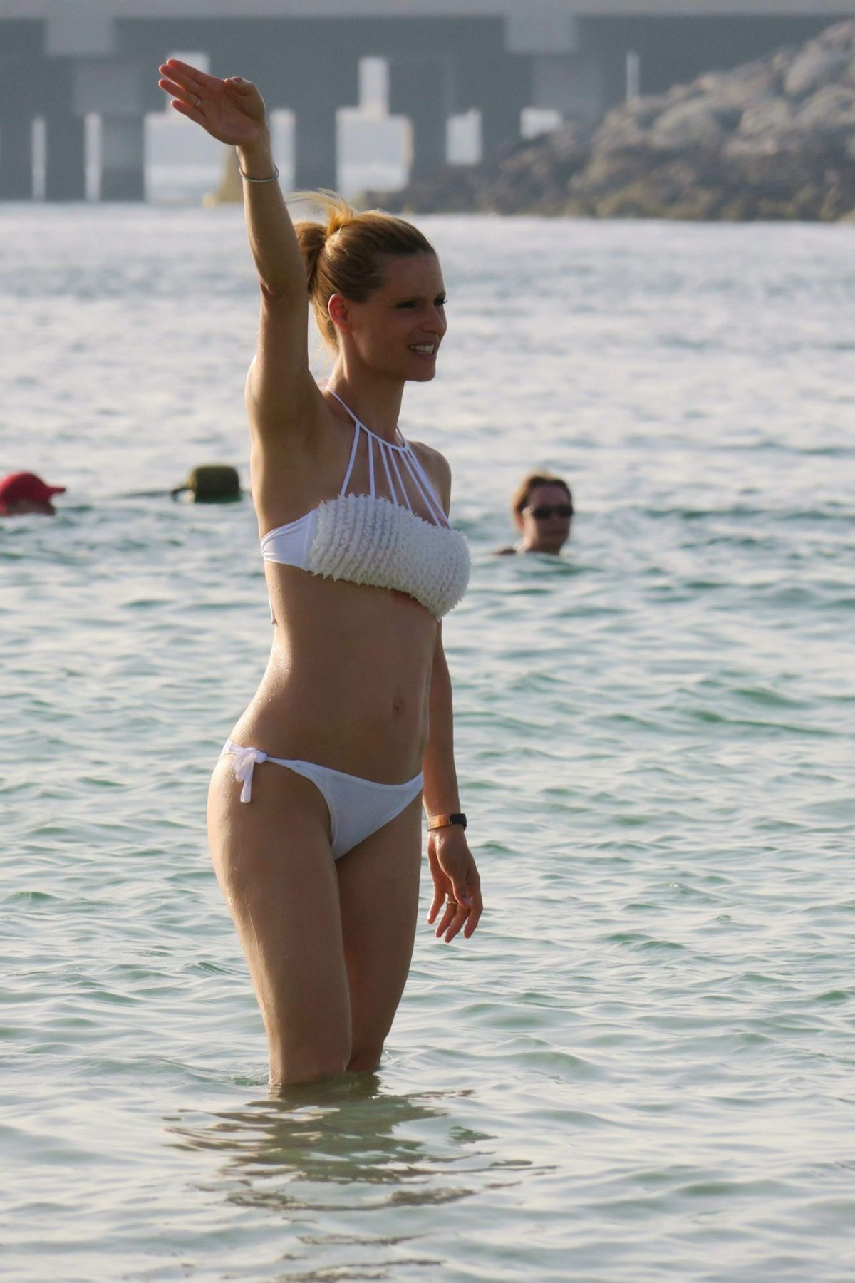 MICHELLE HUNZIKER in Bikini at a Beach in Dubai 04/12/2017