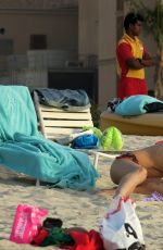 MICHELLE HUNZIKER in Bikini on the Beach in Dubai 04/11/2017