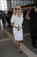 PAMELA ANDERSON Arrives at LAX Airport in Los Angeles 04/25/2017