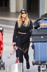 PERRIE EDWARDS at Heathrow Airport in London 04/17/2017