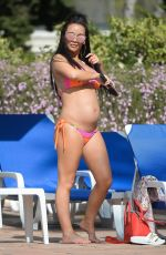 Pregnant CHELSEE HEALEY in Bikini at a Pool in Marbella 04/20/2017