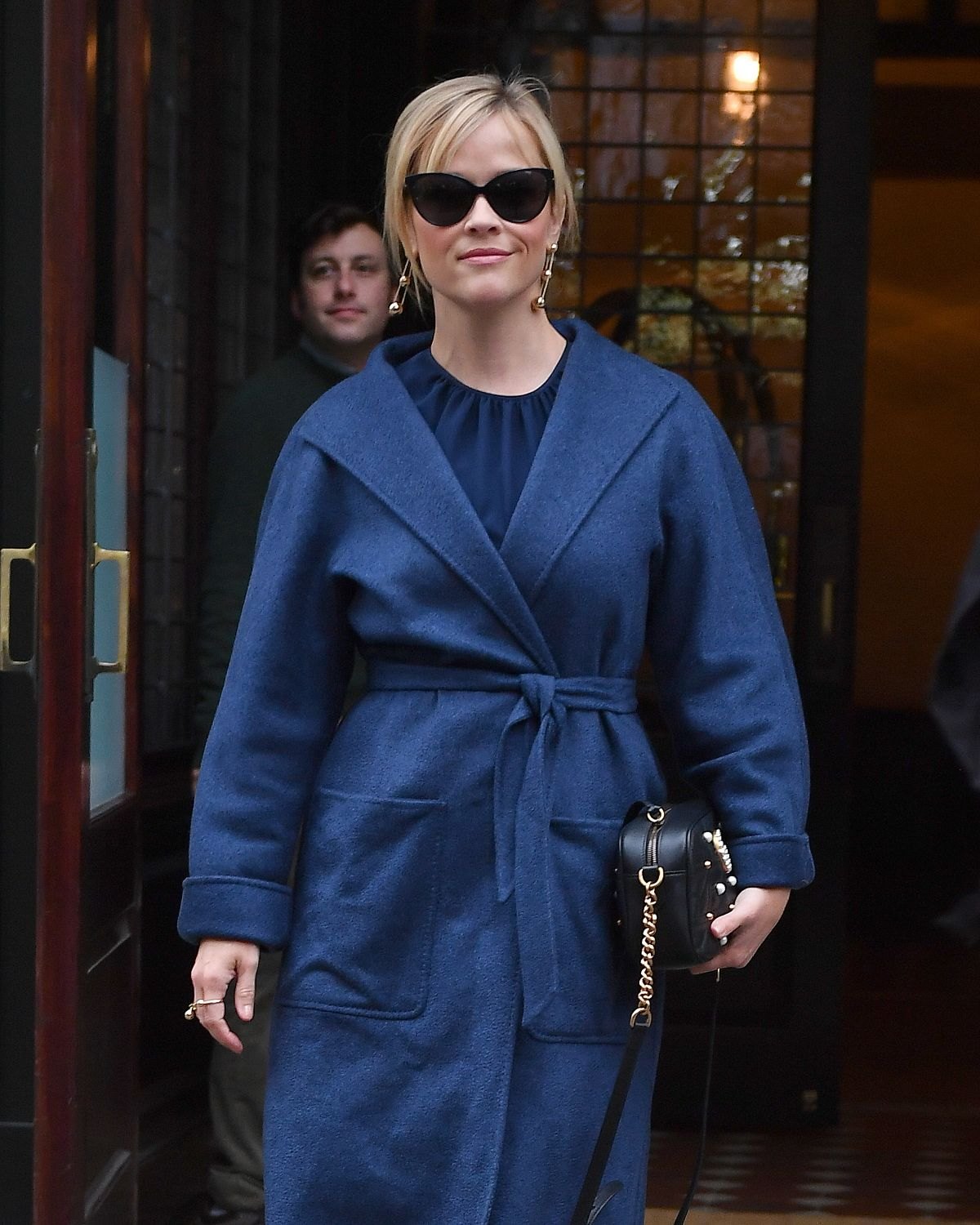 REESE WITHERSPOON in a Blue Coat Out in New York 04/21/2017