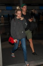 RILEY KEOUGH and Ben Smith-Petersen at LAX Airport in Los Angeles 04/10/2017