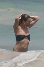 SIENNA MILLER in Bikini at a Beach in Cancun 04/02/2017