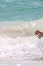 SIENNA MILLER in BIKINI on the Beach in Cancun 04/05/2017