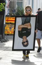 SOFIA RICHIE Holds Framed Photograph of Lou Reed Out in Los Angeles 04/24/2017