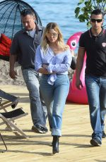 ASHLEY BENSON in Jeans Leaves Martinez Beach in Cannes 05/21/2017