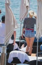 CAROLINE VREELAND in Denim Shorts Out in Cannes 05/25/2017