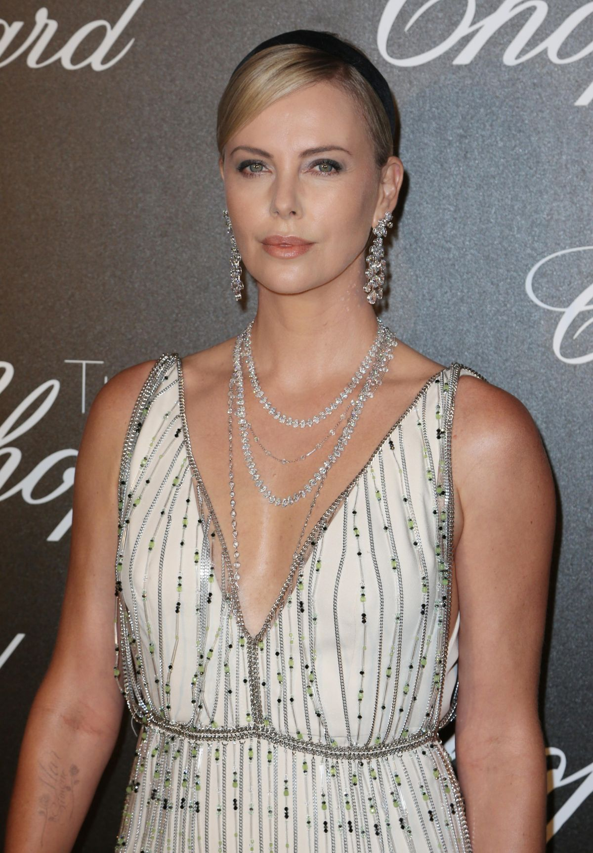 CHARLIZE THERON at Chopard Trophy Event in Cannes 05/22 ... Charlize Theron