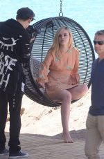 ELLE FANNING on the Set of a Photoshooting on the Beach in Cannes 05/20/2017