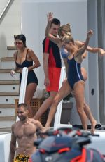 HAILEY BALDWIN in Bikini and CAMI MORRONE in Swimsuit at a Yacht in Cannes 05/23/2017